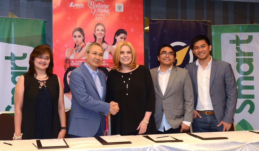 mart, Voyager sign an historic partnership with Binibining Pilipinas, powering the SMS voting for Filipino fans' favorite candidates. The winner of the SMS fan vote will automatically be included in the Top 15 finalists during the Grand Coronation Night at the Smart Araneta Coliseum on April 30. In photo are (from left) Uniprom, Inc. Chief Operating Officer Irene Jose, Smart Public Affairs Head Ramon Isberto, Binibining Pilipinas Charities, Inc. Chair Stella Márquez-Araneta, Voyager Chief Operating Officer Benjie Fernandez, and Voyager VP and Head of Voyager Business Dindo Marzan.